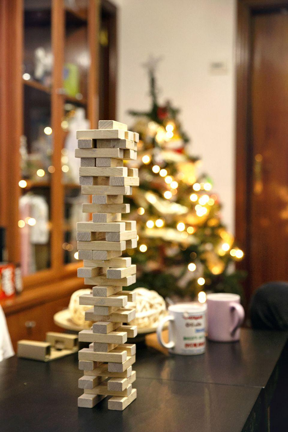 """<p><a href=""""https://www.oprahmag.com/life/g33643974/christmas-party-games/"""" rel=""""nofollow noopener"""" target=""""_blank"""" data-ylk=""""slk:Christmas games"""" class=""""link rapid-noclick-resp"""">Christmas games</a> aren't just for kids—and dedicating your evening to playing a few is an easy way to infuse a regular old Friday night with some holiday merriment. Think: Christmas movie trivia, holiday charades, a kid-friendly <a href=""""https://go.redirectingat.com?id=74968X1596630&url=https%3A%2F%2Fwww.etsy.com%2Flisting%2F736206761%2Fchristmas-scavenger-hunt-printable%3Fsource%3Daw%26awc%3D6220_1603727963_dbb5630be3071a90a6995945bf653635&sref=https%3A%2F%2Fwww.oprahmag.com%2Flife%2Fg34454588%2Fchristmas-activities%2F"""" rel=""""nofollow noopener"""" target=""""_blank"""" data-ylk=""""slk:scavenger hunt"""" class=""""link rapid-noclick-resp"""">scavenger hunt</a>, festive <a href=""""https://www.amazon.com/dp/0515157090?linkCode=ogi&tag=syn-yahoo-20&ascsubtag=%5Bartid%7C10072.g.34454588%5Bsrc%7Cyahoo-us"""" rel=""""nofollow noopener"""" target=""""_blank"""" data-ylk=""""slk:Mad Libs"""" class=""""link rapid-noclick-resp"""">Mad Libs</a>, or a good old fashioned<a href=""""https://www.oprahmag.com/life/g28436280/games-to-play-with-friends/"""" rel=""""nofollow noopener"""" target=""""_blank"""" data-ylk=""""slk:board game"""" class=""""link rapid-noclick-resp""""> board game</a>.</p>"""