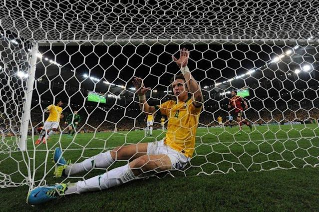 Brazil's defender David Luiz reacts after pulling off a save during the FIFA Confederations Cup Brazil 2013 final football match against Spain, at the Maracana Stadium in Rio de Janeiro on June 30, 2013. Brazil won 3-0