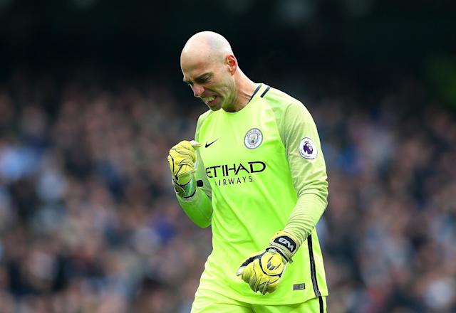 <p>Willy Cabellero of Manchester City celebrates after his side take the lead through Gabriel Jesus (not pictured) during the Premier League match between Manchester City and Swansea City at Etihad Stadium on February 5, 2017 in Manchester, England. </p>