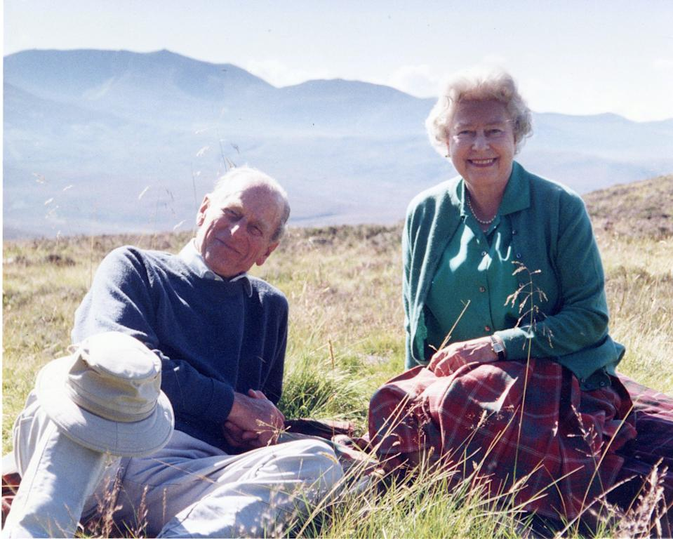 <p>The royals are pictured relaxing at Coyles of Muick, a beauty spot near the town of Ballater in Aberdeenshire</p> (PA)
