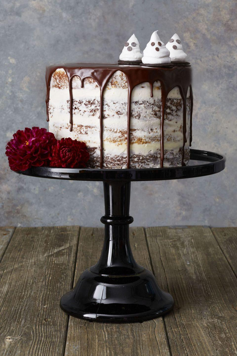 """<p>Garnish this spicy chocolate cake with sugar ghosts and a dripping layer of rich chocolate for the most decadent dessert. </p><p><em><a href=""""https://www.goodhousekeeping.com/food-recipes/dessert/a46068/pumpkin-devils-food-layer-cake-recipe/"""" rel=""""nofollow noopener"""" target=""""_blank"""" data-ylk=""""slk:G"""" class=""""link rapid-noclick-resp"""">G</a></em><em><a href=""""https://www.goodhousekeeping.com/food-recipes/dessert/a46068/pumpkin-devils-food-layer-cake-recipe/"""" rel=""""nofollow noopener"""" target=""""_blank"""" data-ylk=""""slk:et the recipe for Pumpkin and Devil's Food Layer Cake »"""" class=""""link rapid-noclick-resp"""">et the recipe for Pumpkin and Devil's Food Layer Cake »</a></em></p>"""