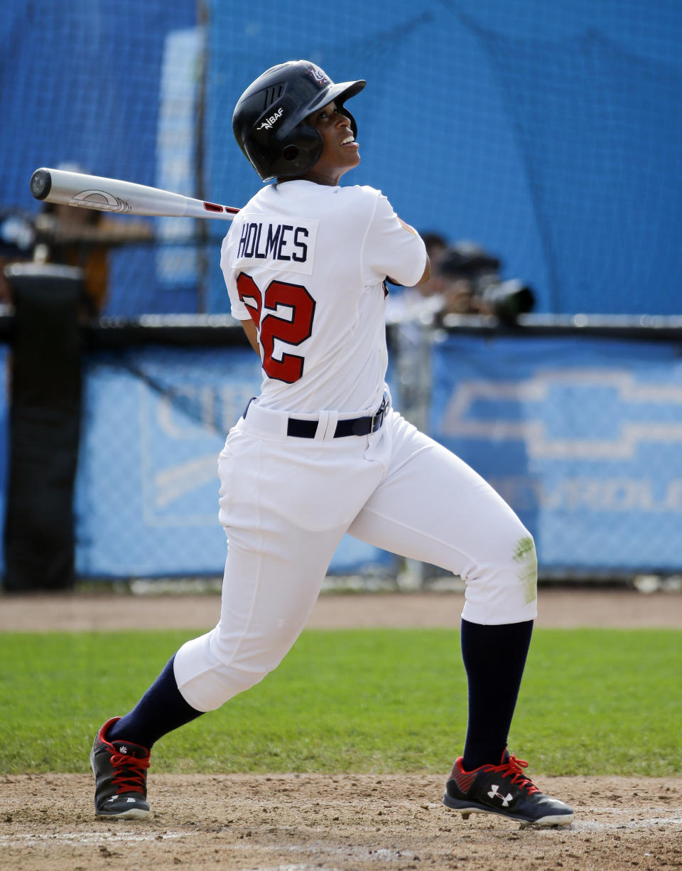 Tamara Holmes, of the United States, watches her hit during a women's baseball game against Venezuela at the Pan Am Games Monday, July 20, 2015, in Ajax, Ontario. Women's baseball made history on Monday at the Pan Am Games, the first time it has been played in a large, multi-sport event.(AP Photo/Mark Humphrey)