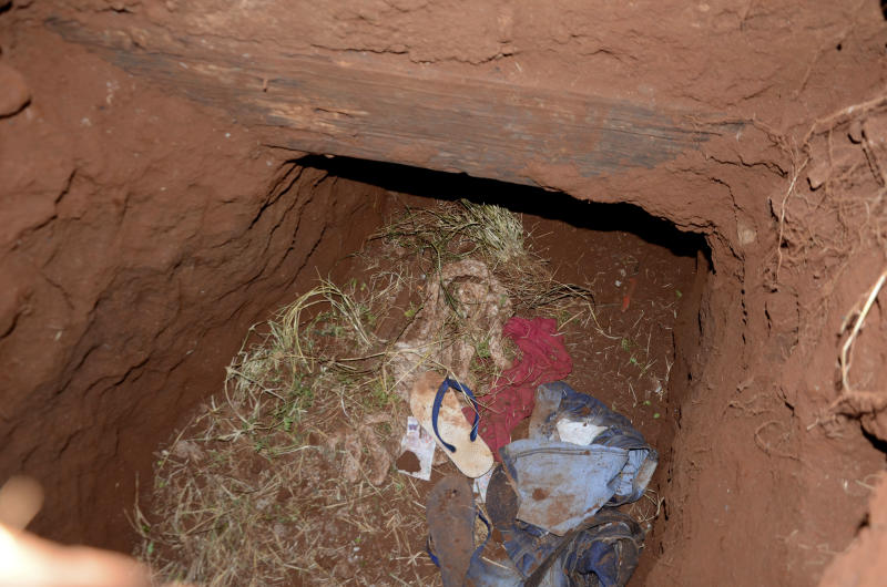 """Clothes are seen in a tunnel entrance at Pedro Juan Caballero city jail in Paraguay, Sunday, Jan. 19, 2020. Dozens of inmates escaped from this prison early morning, mostly of Brazil's criminal group PCC, """"Capital First Command."""" (AP Photo/Marciano Candia)"""