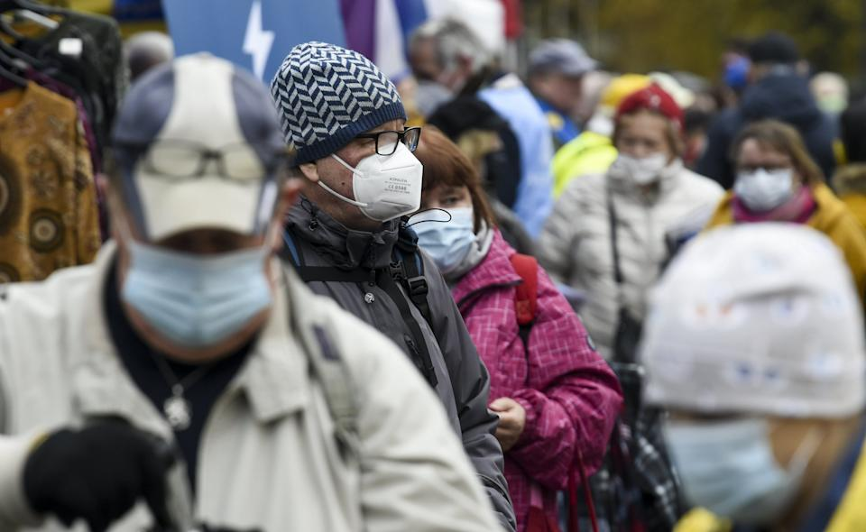 People wear face masks at the Hakaniemi Sunday market in Helsinki, Finland, on November 1, 2020, amid the novel coronavirus COVID-19 pandemic. - Finland has now 16 291 confirmed cases of Covid-19 with 358 fatalities. (Photo by Markku Ulander / Lehtikuva / AFP) / Finland OUT (Photo by MARKKU ULANDER/Lehtikuva/AFP via Getty Images)