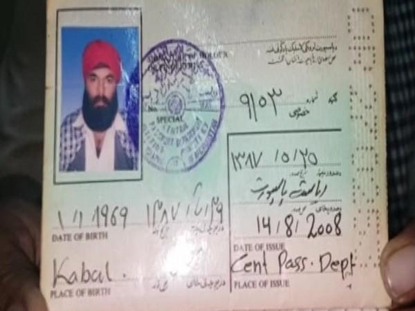 A Sikh refugee showing his Afghan passport in Ludhiana on Saturday. [Photo/ANI]