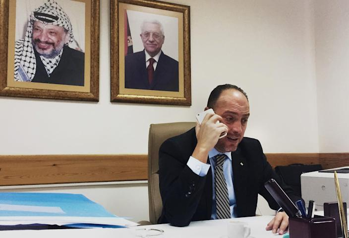 Dr. Husam Zomlot, senior adviser to Palestinian President Mahmoud Abbas, speaks on the phone, saying that he hopes the United States will not move its embassy to Jerusalem and undercut peace talks. (Photo: Ash Gallagher for Yahoo News)