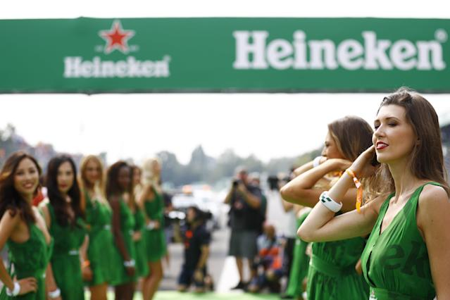 It starts with He, not She: Heineken's grid girls in their unmistakeable outfits