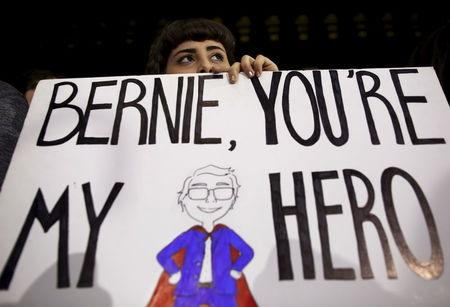 A supporter listens to U.S. Democratic presidential candidate Bernie Sanders at a campaign rally in Ann Arbor