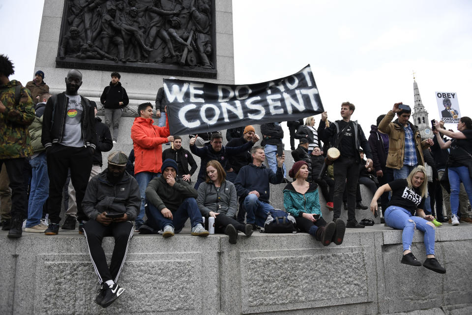 People without face masks attend a protest against government restrictions to curb the spread of the coronavirus, in London, Saturday, March 20, 2021. (AP Photo/Alberto Pezzali)