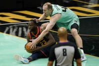 Golden State Warriors forward Draymond Green (23) and Charlotte Hornets center Cody Zeller battle for a loose ball during the second half of an NBA basketball game on Saturday, Feb. 20, 2021, in Charlotte, N.C. (AP Photo/Chris Carlson)