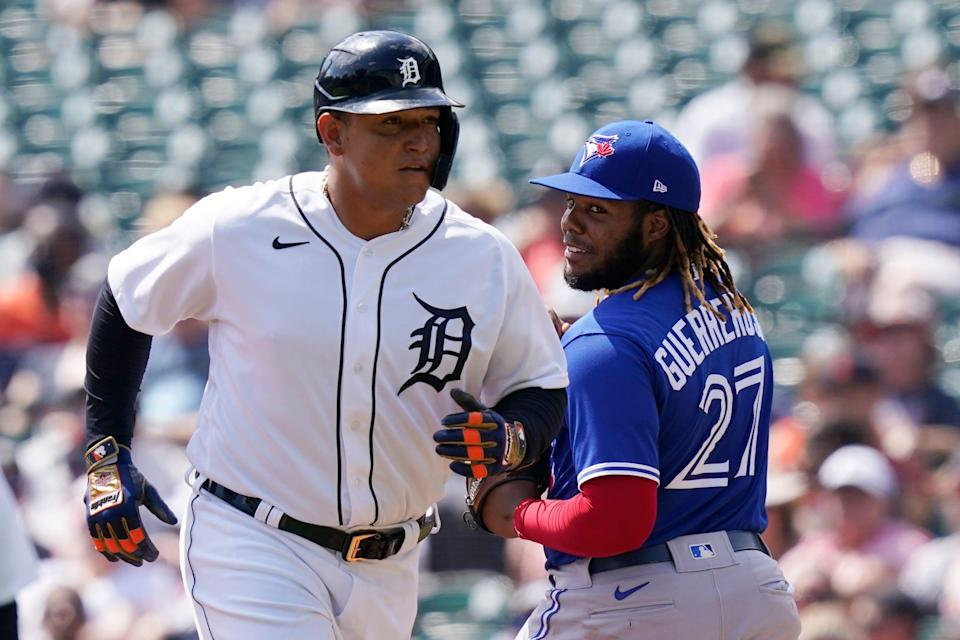 Toronto Blue Jays first baseman Vladimir Guerrero Jr. (27) looks back as Detroit Tigers designated hitter Miguel Cabrera heads back to the dugout after grounding out during the second inning of a baseball game, Sunday, Aug. 29, 2021, in Detroit.