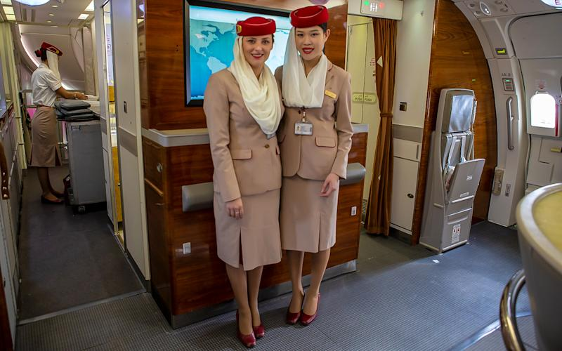 Cabin crew will be in their full uniform when passengers board the aircraft. | Talia Avakian