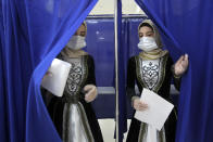 Chechen women weared Chechen national costumes leave a polling booth at a polling station during the Parliamentary elections in Grozny, Russia, Sunday, Sept. 19, 2021. Russia has begun the third day of voting for a new parliament that is unlikely to change the country's political complexion. There's no expectation that United Russia, the party devoted to President Vladimir Putin, will lose its dominance in the State Duma. (AP Photo/Musa Sadulayev)