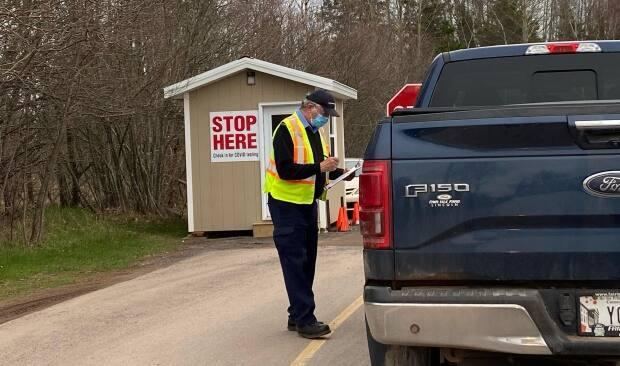 A driver arriving to be swabbed gets instructions on Friday morning at the COVID-19 testing clinic at the Royal Canadian Legion Branch in Montague, P.E.I. (Carolyn Ryan/CBC - image credit)
