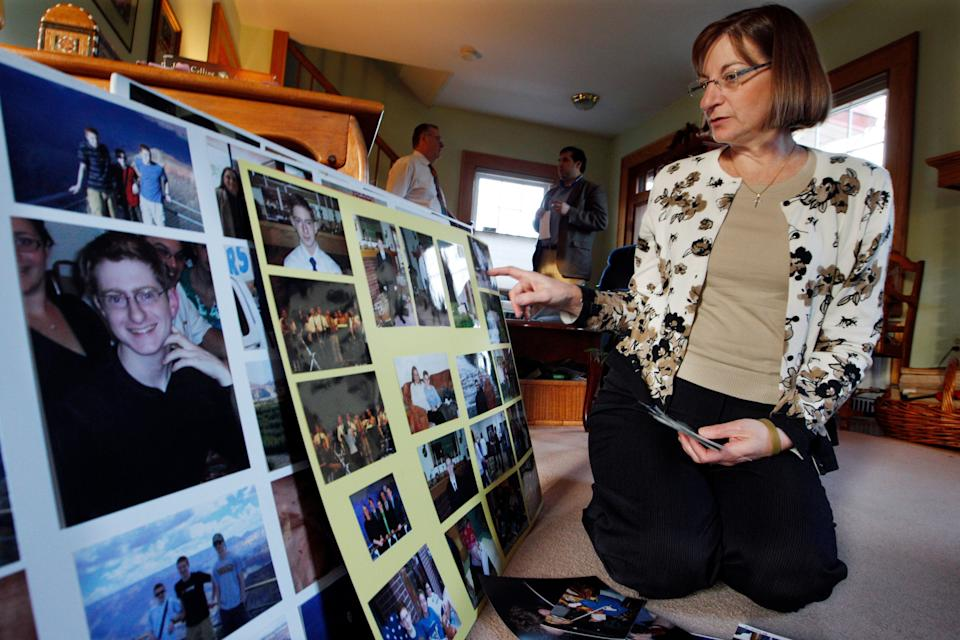 In this Dec. 9, 2011, file photo, Jane Clementi, right, the mother of Tyler Clementi, looks at family photographs in their home in Ridgewood, New Jersey. (Photo: (AP Photo/Mel Evans, File))