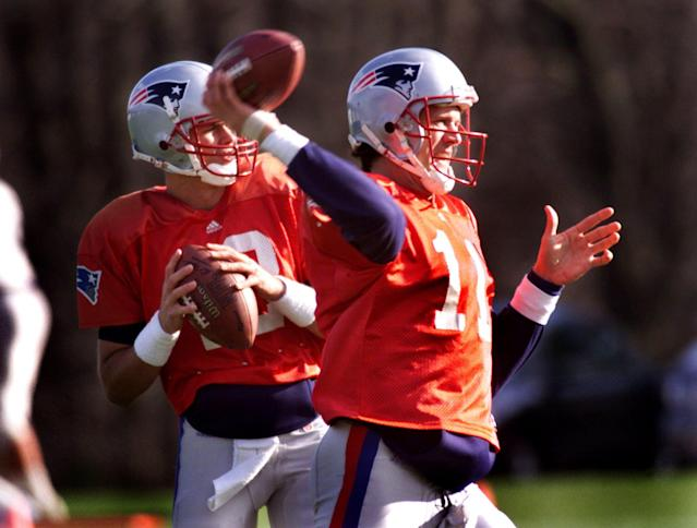 Drew Bledsoe and backup Tom Brady during a practice in 2000 after Brady was selected with the 199th pick in that year's NFL draft. (Photo by Barry Chin/The Boston Globe via Getty Images)