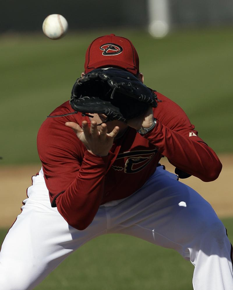 Arizona Diamondbacks pitcher Jarrod Parker goes through drills at the team's spring training baseball facility in Scottsdale, Ariz. Monday, Feb. 14, 2011. (AP Photo/Marcio Jose Sanchez)