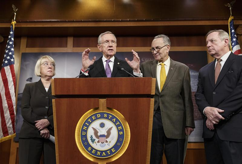 From left, Sen. Patty Murray, D-Wash., chair of the Senate Budget Committee, Senate Majority Leader Harry Reid, D-Nev., Sen. Chuck Schumer, D-N.Y., and Senate Majority Whip Dick Durbin, D-Ill., talk to reporters about the final work of the Senate as their legislative year nears to a close, at the Capitol in Washington, Thursday, Dec. 19, 2013. Reid promises a vote no later than Jan. 7 on a measure to extend jobless benefits for three months. He said the number of jobless people out of work for more than six months is far greater than in past economic recoveries. (AP Photo/J. Scott Applewhite)