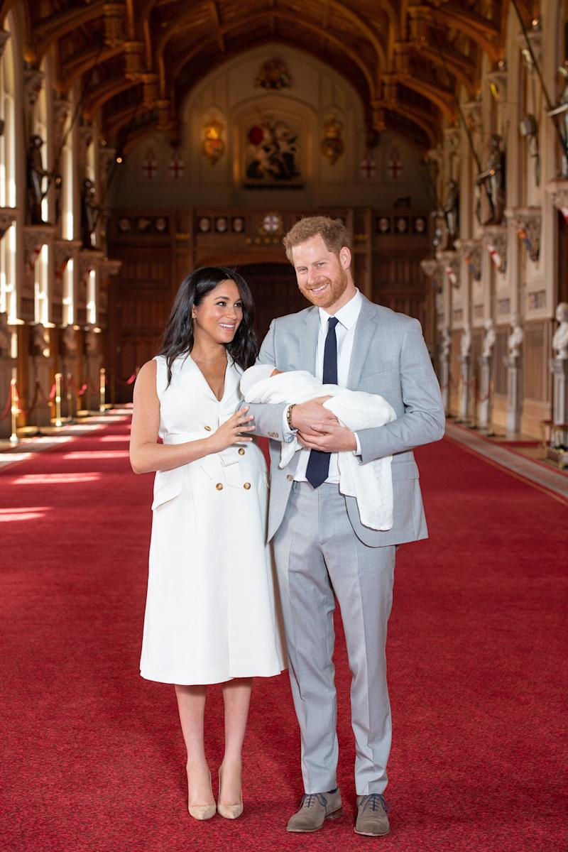 Prince Harry, Duke of Sussex and Meghan, Duchess of Sussex, pose with their newborn son, Prince Archie Harrison Mountbatten-Windsor during a photocall in St George's Hall at Windsor Castle on May 8, 2019 in Windsor, England. The Duchess of Sussex gave birth at 05:26 on Monday 06 May, 2019. (Photo: Dominic Lipinski - WPA Pool/Getty Images)