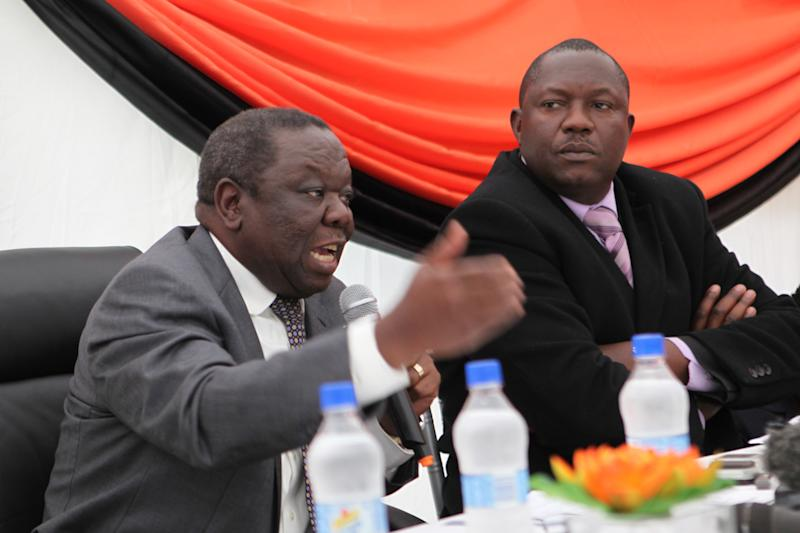 Zimbabwean Prime Minster Morgan Tsvangirai, left, and Okay Machisa, Director of Zimbabwe Human Rights Association, during a  press briefing of leaders from the civic society in Harare, Wednesday, June, 12, 2013. Zimbabwe's prime minister says he won't agree to hold crucial elections on a date set by a court for end of July. Prime Minister Morgan Tsvangirai said Wednesday that President Robert Mugabe cannot decide on an election date without the consent of other leaders in the power-sharing government. (AP Photo/Tsvangirayi Mukwazhi)