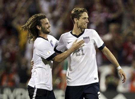 United States players Kyle Beckerman (L) and Clarence Goodson celebrate their victory over Mexico in their 2014 World Cup qualifying soccer match in Columbus, Ohio September 10, 2013. REUTERS/Matt Sullivan