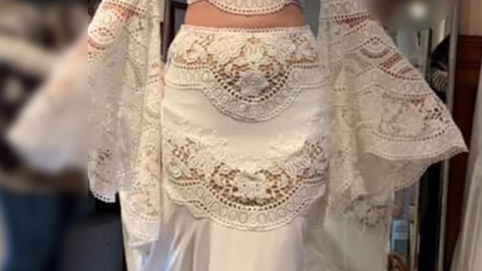 Close view shows lace leaves bride's nether regions exposed in two piece wedding dress