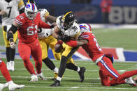 Buffalo Bills free safety Jordan Poyer, right, forces a fumble by Pittsburgh Steelers running back James Conner (30) during the first half of an NFL football game in Orchard Park, N.Y., Sunday, Dec. 13, 2020. The ball was recovered by the Steelers. (AP Photo/Adrian Kraus)