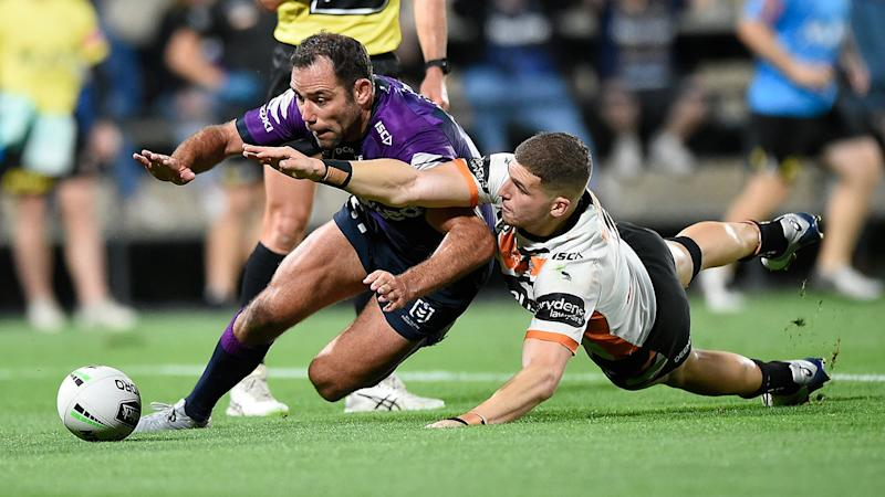 Pictured here, Cam Smith touches down for a try against the Wests Tigers.