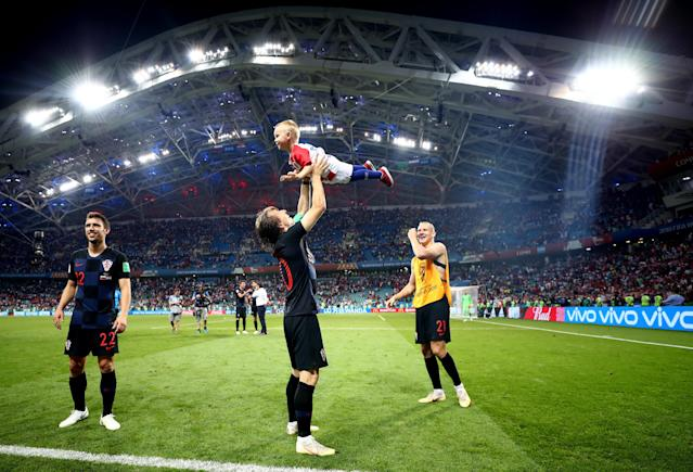 <p>Luka Modric of Croatia celebrates with Domagoj Vida of Croatia's son following Croatia's victory in the 2018 FIFA World Cup Russia Quarter Final match between Russia and Croatia at Fisht Stadium on July 7, 2018 in Sochi, Russia. (Photo by Lars Baron – FIFA/FIFA via Getty Images) </p>