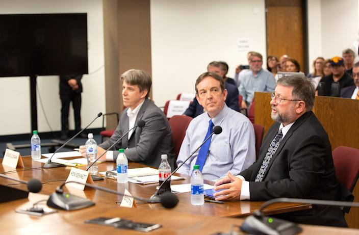 Cyber Ninjas CEO Doug Logan (from left), Arizona Senate's liaison for the Maricopa County election audit Ken Bennett, and CyFIR founder Ben Cotton are seen at the Arizona State Senate in Phoenix on July 15, 2021.