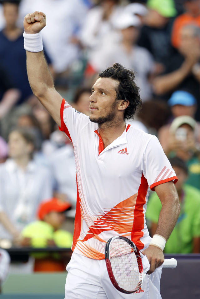Juan Monaco, of Argentina, acknowledges fans after his 7-5, 6-0 win over Andy Roddick, of the United States, during the Sony Ericsson Open tennis tournament in Key Biscayne, Fla., Tuesday, March 27, 2012. (AP Photo/Alan Diaz)