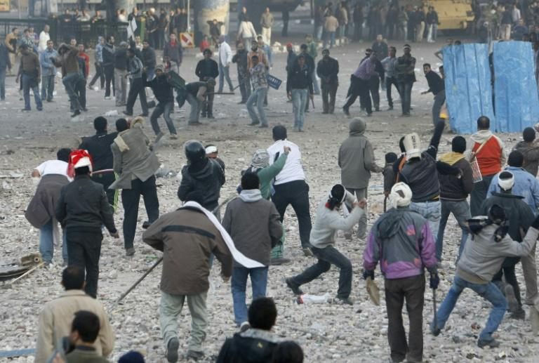 Egyptian anti-government demonstrators (bottom) clash with pro-regime supporters in Cairo's Tahrir Square during the 2011 revolt that deposed Hosni Mubarak