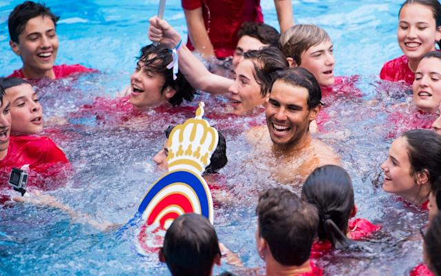 <span>Nadal ended up in a swimming pool with the ballboys and girls</span> <span>Credit: Getty Images </span>