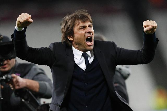 Antonio Conte's Chelsea sit seven points ahead of Tottenham in the Premier League ahead of their clash against Manchester United on April 16 (AFP Photo/Adrian DENNIS)