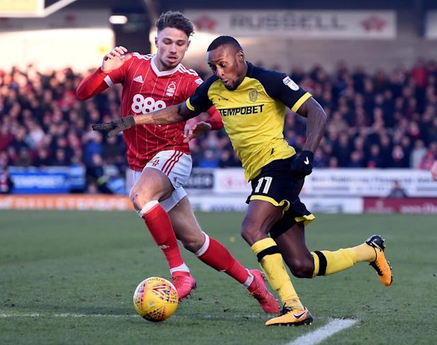 "Soccer Football - Championship - Burton Albion vs Nottingham Forest - Pirelli Stadium, Burton-on-Trent, Britain - February 17, 2018 Burton's Lloyd Dyer in action with Nottingham Forest's Matthew Cash Action Images/Alan Walter EDITORIAL USE ONLY. No use with unauthorized audio, video, data, fixture lists, club/league logos or ""live"" services. Online in-match use limited to 75 images, no video emulation. No use in betting, games or single club/league/player publications. Please contact your account representative for further details."