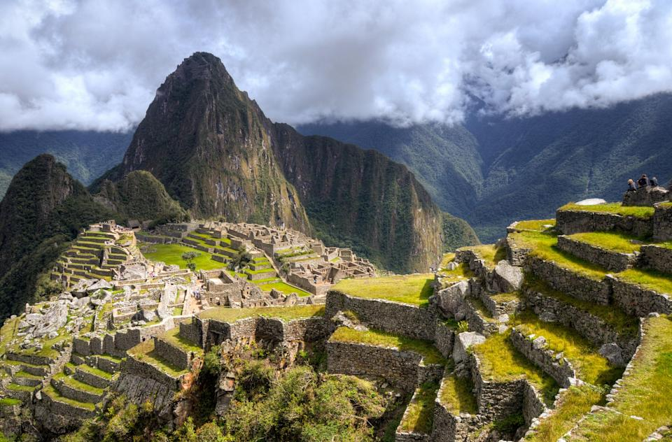 "Arriving to Machu Picchu on foot is on many travelers' lists for a reason. But because visiting the site, by trek or otherwise, has become so popular—with the ancient Incan ruins suffering from <a href=""https://www.cntraveler.com/story/we-are-not-trampling-machu-picchu-out-of-existence?mbid=synd_yahoo_rss"" rel=""nofollow noopener"" target=""_blank"" data-ylk=""slk:overtourism"" class=""link rapid-noclick-resp"">overtourism</a> in recent years—the Peruvian government has <a href=""https://www.cntraveler.com/story/machu-picchus-ticket-policy-explained?mbid=synd_yahoo_rss"" rel=""nofollow noopener"" target=""_blank"" data-ylk=""slk:placed caps"" class=""link rapid-noclick-resp"">placed caps</a> on how many people can visit daily. They've also capped trekker capacity on the historic Inca Trail, a journey that can take anywhere from a couple days, to a week. Book in advance to visit during the dry season (from roughly April to October), which will also help you secure one of just 400 daily tickets to climb up the iconic peak of Huayna Picchu, offering great views over the ruins for a lucky few."