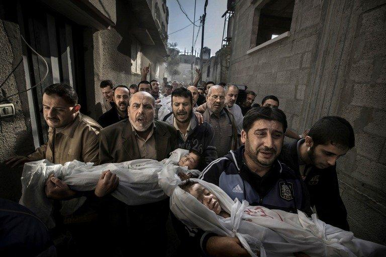 This photo by Paul Hansen shows two Palestinian children killed in Israeli air strike on Gaza City, on November 20, 2012