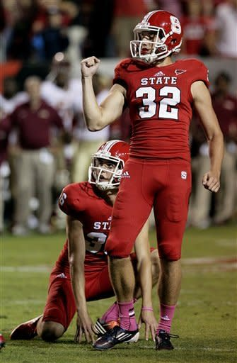 North Carolina State's Niklas Sade (32) reacts with Wil Baumann (36) after Sade's extra point to win the game against Florida State late in the second half of an NCAA college football game in Raleigh, N.C., Saturday, Oct. 6, 2012. North Carolina State won 17-16. (AP Photo/Gerry Broome)