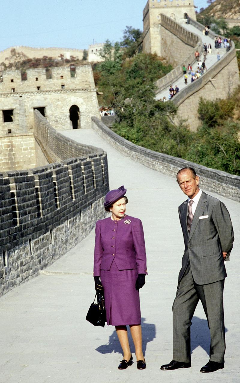 The Queen and the Duke of Edinburgh visit the Great Wall of China near Peking - Credit: Tim Graham/Getty Images