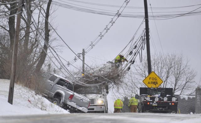 <p>A linesmen works on repairing down wires from a pickup-truck that lost control in Johnstown, Pa., on Friday, March 2, 2018. (Photo: Todd Berkey/The Tribune-Democrat via AP) </p>
