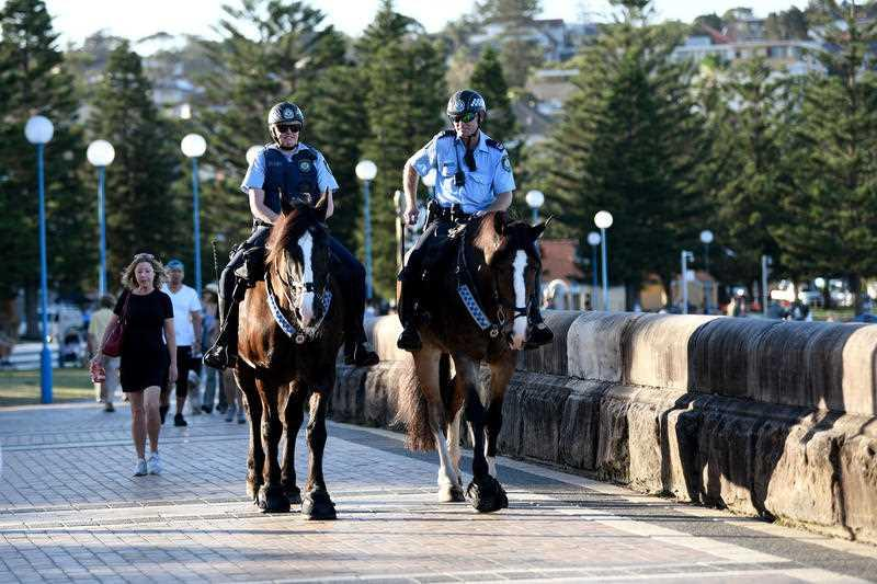 Mounted police are seen patrolling a closed Coogee Beach in Sydney.