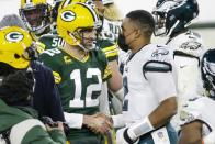 Green Bay Packers' Aaron Rodgers shakes hands with Philadelphia Eagles' Jalen Hurts after an NFL football game Sunday, Dec. 6, 2020, in Green Bay, Wis. The Packers won 30-16. (AP Photo/Mike Roemer)