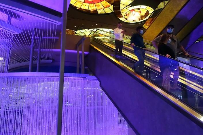 """Visitors wearing masks inside the Cosmopolitan of Las Vegas in early July. <span class=""""copyright"""">(Dania Maxwell / Los Angeles Times)</span>"""