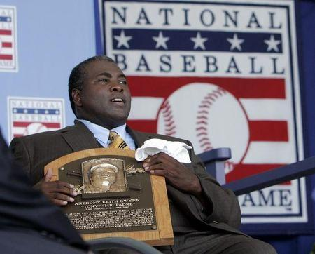 Former San Diego Padre Gwynn holds his Hall of Fame plaque following his induction into the National Baseball Hall of Fame in Cooperstown
