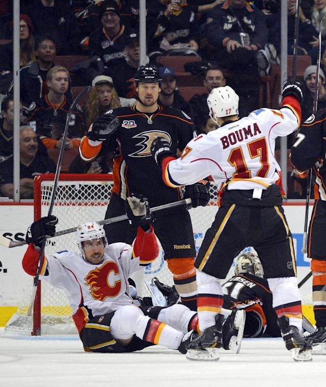 Calgary Flames right wing David Jones, left, celebrates his goal along with left wing Lance Bouma, upper right, as Anaheim Ducks defenseman Nolan Yonkman, second from left, looks on and goalie Frederik Andersen, of Denmark, lays on the ice during the second period of an NHL hockey game, Friday, Nov. 29, 2013, in Anaheim, Calif. (AP Photo/Mark J. Terrill)