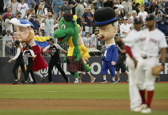 Characters including from left, King Henry VIII, the Loch Ness monster and Winston Churchill participate in a mascot race during a baseball game between the Boston Red Sox and the New York Yankees, Saturday, June 29, 2019, in London. Major League Baseball made its European debut game Saturday at London Stadium. (AP Photo/Tim Ireland)