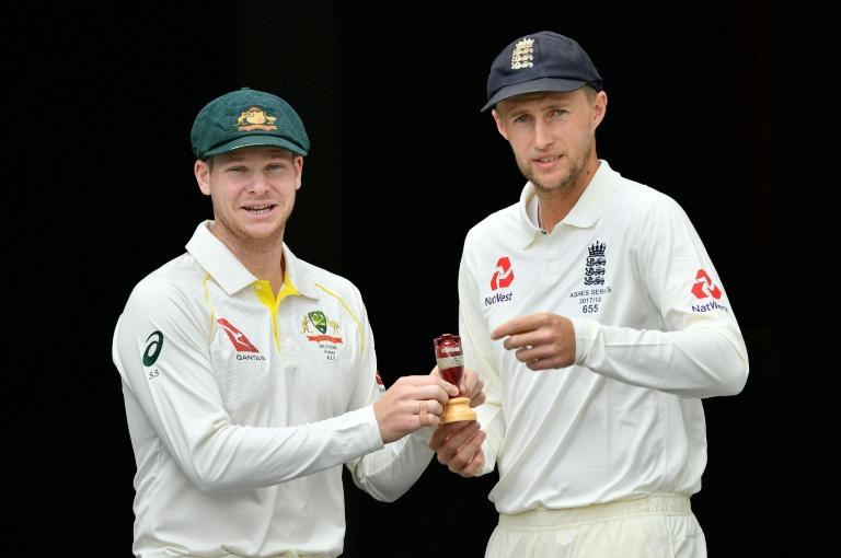 Australia's skipper Steve Smith (L) and Joe Root, Captain of England, pose at a media opportunity in Brisbane on November 22, 2017, on the eve of their first Ashes Test match