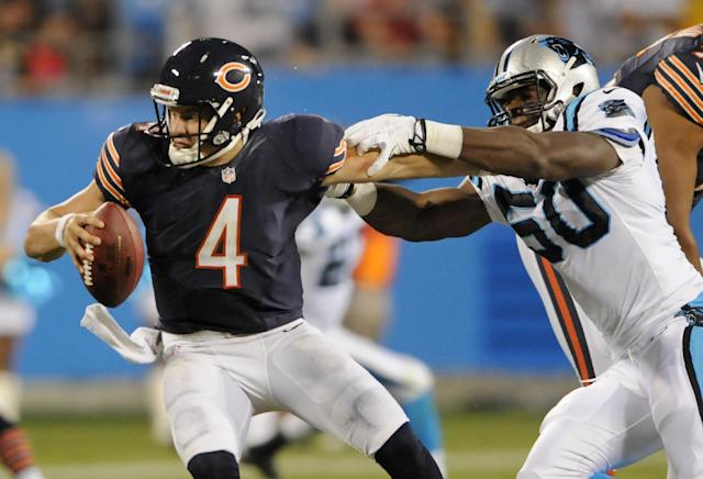 Chicago Bears' Matt Blanchard (4) is tackled by Carolina Panthers' Louis Nzegwu (50) during the second half of a preseason NFL football game in Charlotte, N.C., Friday, Aug. 9, 2013. The Panthers won 24-17. (AP Photo/Mike McCarn)