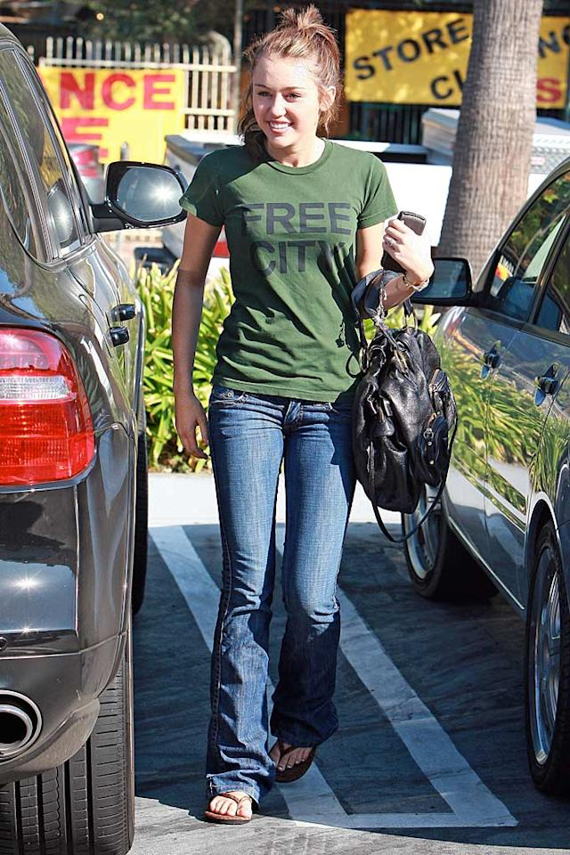 "Was Miley Cyrus trying to hide from the paps in this camouflage-colored t-shirt? <a href=""http://www.infdaily.com"" target=""new"">INFDaily.com</a> - August 9. 2008"