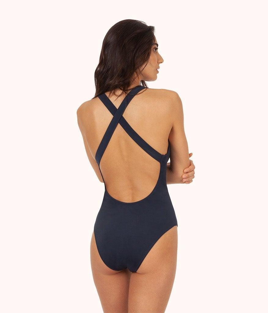 """<h3><h2>Lively</h2></h3><br>Your favorite start-up lingerie brand is now in the business of swim, with four new maillot styles made from recycled polyester. Lively's signature vibe — active, but with curb appeal — is present in these eco-friendly suits.<br><br><em>Shop swimwear at <strong><a href=""""https://www.wearlively.com/collections/swim"""" rel=""""nofollow noopener"""" target=""""_blank"""" data-ylk=""""slk:Lively"""" class=""""link rapid-noclick-resp"""">Lively</a></strong></em><br><br><strong>Lively</strong> The Crossback One Piece, $, available at <a href=""""https://go.skimresources.com/?id=30283X879131&url=https%3A%2F%2Fwww.wearlively.com%2Fcollections%2Fswim%2Fproducts%2Fthe-crossback-one-piece-navy%3Fvariant%3D32462681374816"""" rel=""""nofollow noopener"""" target=""""_blank"""" data-ylk=""""slk:Lively"""" class=""""link rapid-noclick-resp"""">Lively</a>"""